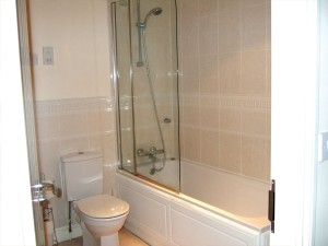 En-suite bathrooms on first and second floors.