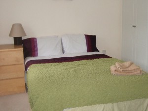 Two double rooms with shared en-suite bathroom.