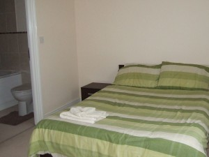 Two double rooms with shared family bathroom.
