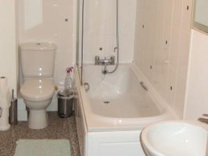 Ground floor toilet, first floor bathroom and en-suite bathroom to master bedroom.