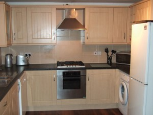Fully fitted kitchen with fridge freezer, oven, microwave and dishwasher.