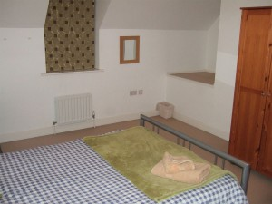 Three double rooms of similar size, fully furnished including desks.
